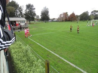 Reserves defend a corner near the clubrooms