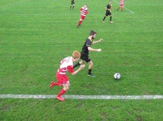 Jordan makes a tackle and bursts forward